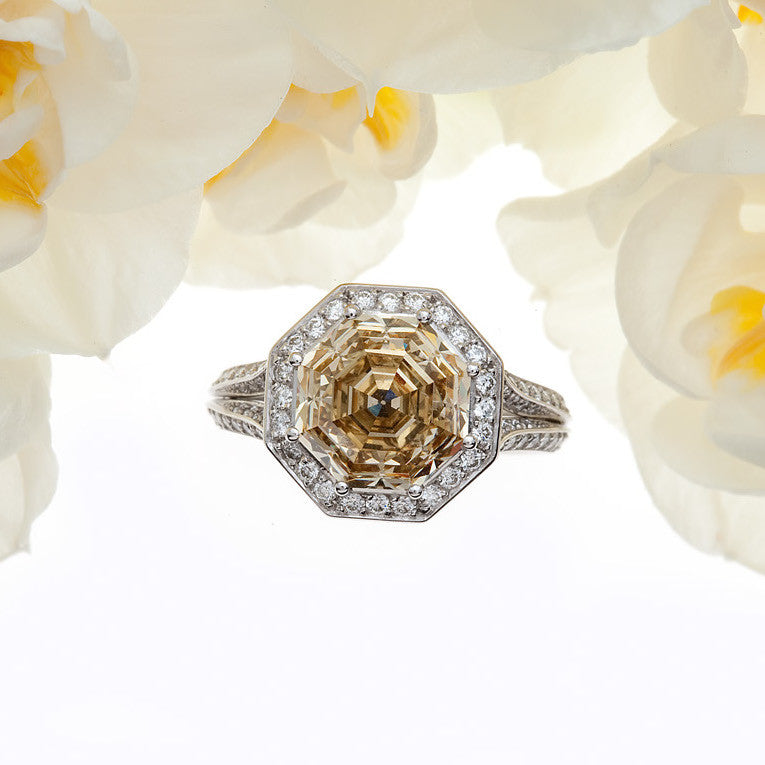 Platinum diamond engagement ring with one natural fancy deep brownish yellow octagonal-cut diamond (VS2), and 96 round brilliant diamonds