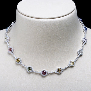 18K white gold necklace set with 635 round brilliant diamonds and 17 mixed fancy-colored natural sapphires