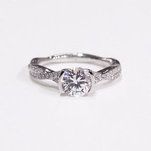 "Lazare Kaplan 18K white gold ""Twist"" semi-mount engagement ring with a half bezel center setting, and side diamonds"