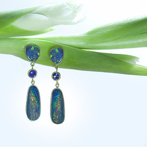 18K yellow gold earrings set with boulder opal and round brilliant sapphires