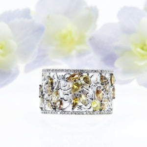 18K white gold diamond band with white and fancy colored diamonds