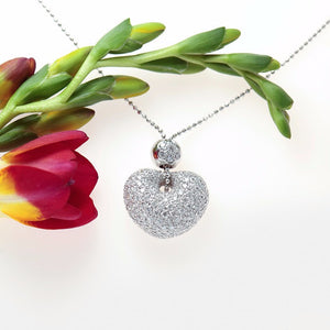 18k white gold puff heart pendant pave set with 152 round brilliant full cut diamonds