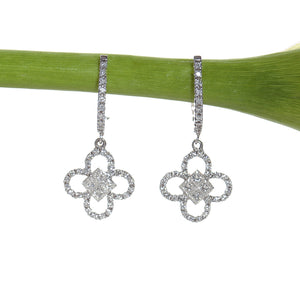 18K white gold clover drop earrings set with princess and round cut diamonds
