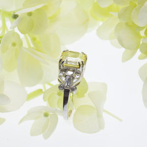 Side view of one natural unheated, untreated asscher-cut yellow sapphire weighing 3.92 carats set in a platinum antique setting, ring