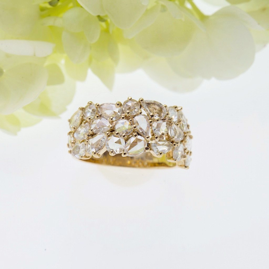 Front facing view of 18K rose gold diamond ring with 23 rose-cut diamonds