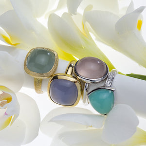 14K or 18K white or yellow gold fashion rings featuring a cabochon-cut chalcedony or aquamarine centerstone in a bezel setting