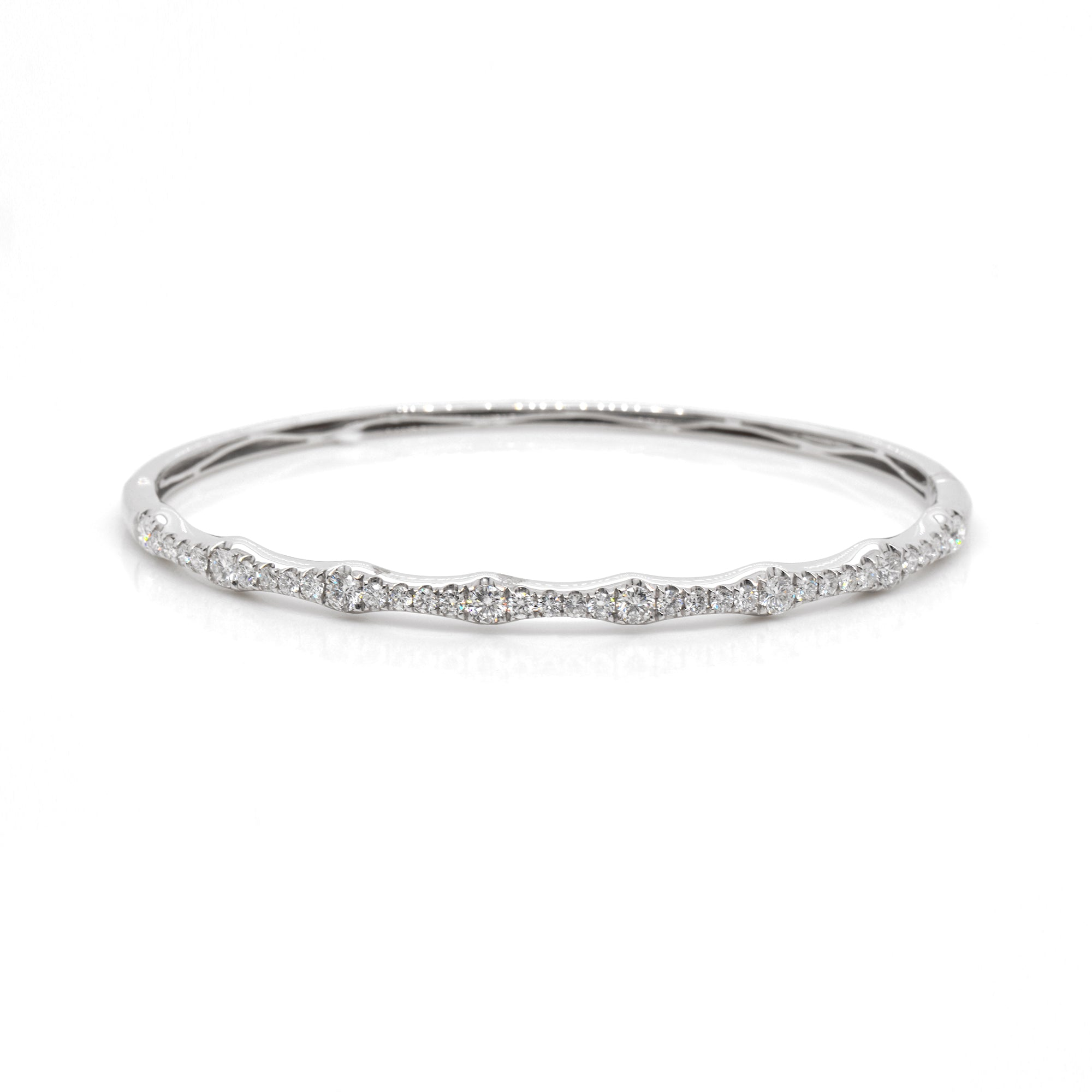 18K white gold diamond bangle featuring round brilliant diamonds