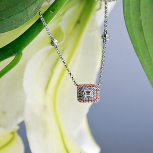 14K rose gold and white gold necklace with 1 emerald-cut diamond weighing 0.31 carats, and 42 brilliant cut diamonds weighing a total of 0.30 carats.