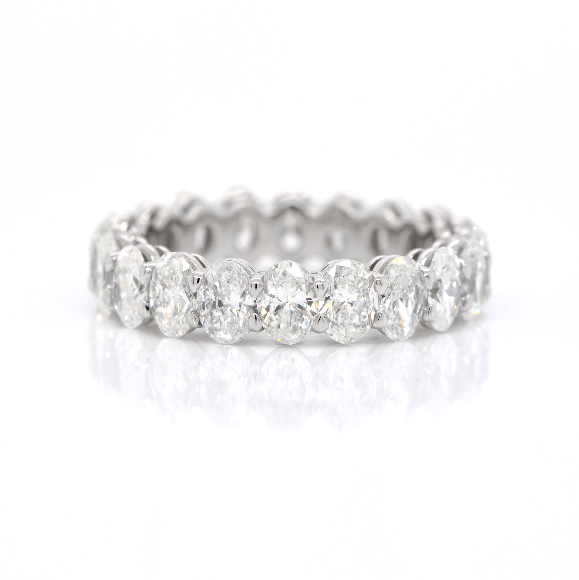 Platinum oval diamond eternity band featuring 20 oval diamonds (F-G color, VS-SI clarity) weighing a total of 4.09 carats.