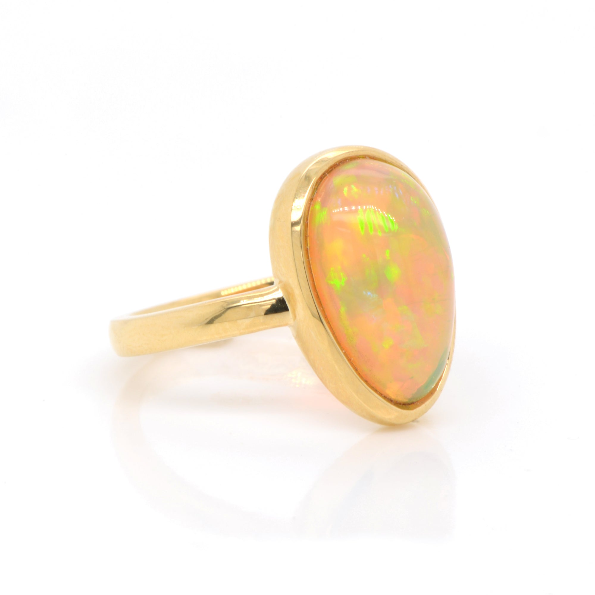 18K yellow gold opal ring featuring one pear-shaped Ethiopian opal weighing 3.52 carats. Judith Arnell Jewelers.