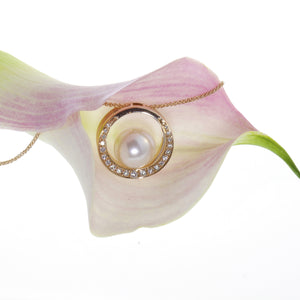 14K rose gold pendant with one 13mm South Sea Pearl, and 21 white brilliant-cut diamonds