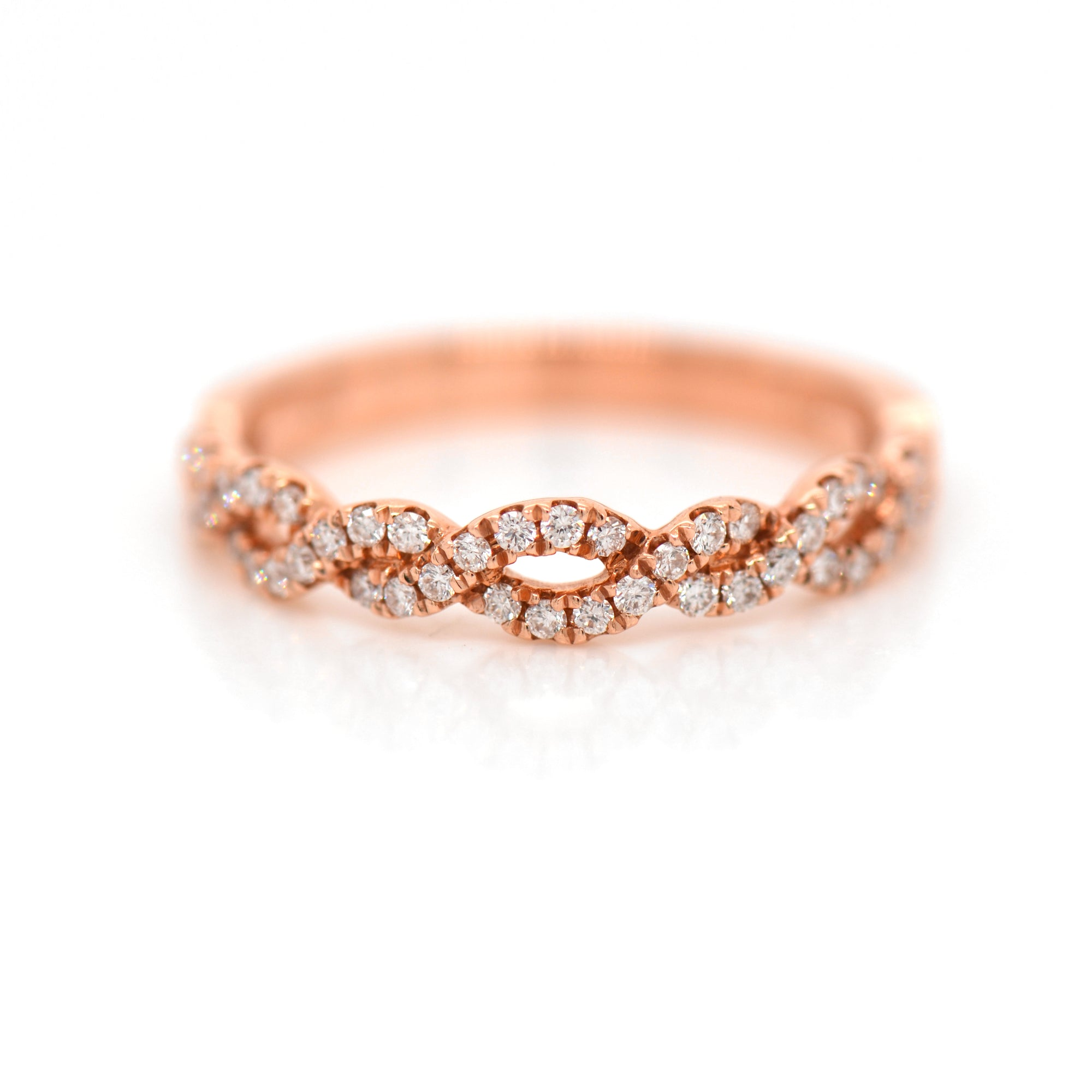 14K rose gold diamond band featuring round brilliant diamonds weighing a total of 0.26 carats set in an interwoven twist design.