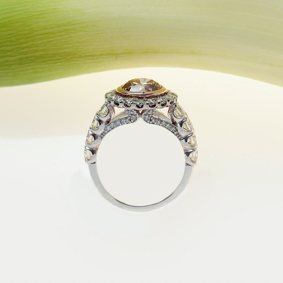 handmade platinum and rose gold ring with a brown pink diamond and white diamonds