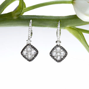 white gold drop earrings with white and black diamonds