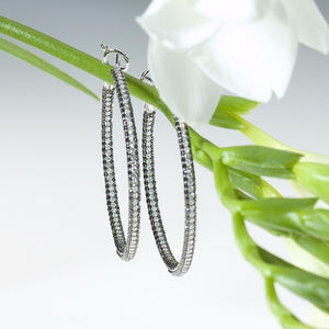 White gold earring hoops with white and black diamonds