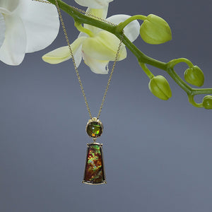 One Of A Kind Ammolite Fossil Pendant on a yellow gold cable link chain