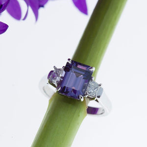 platinum ring featuring a color change blue lavender spinel and diamonds