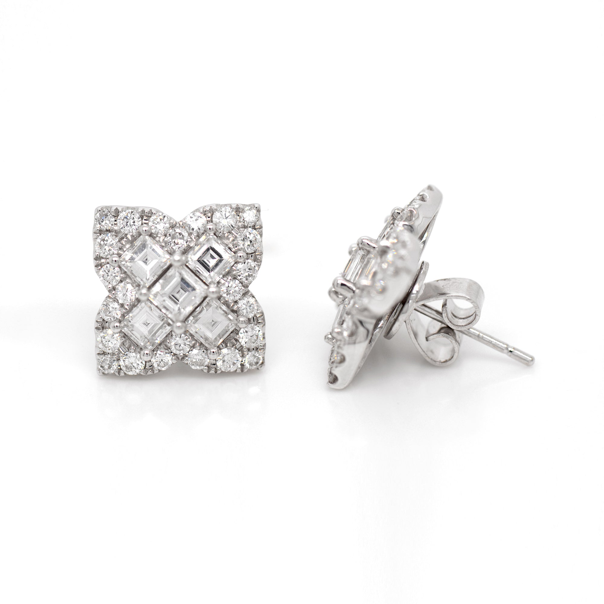 18K white gold diamond earrings feature Asscher and round diamonds weighing a total of 2.69 carats set in a 4-point clover design.