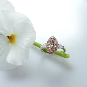 14K white gold diamond engagement ring featuring 1 champagne marquis diamond in a halo of round brilliant pink diamonds, and 2 pear shaped diamond set in a 3-stone design. Custom made to order for any size diamond or gemstone center stone. Available in 14K or 18K white, yellow, rose gold, and platinum.