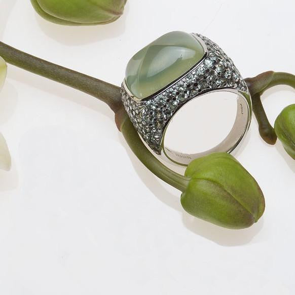 Angled view of white gold prehnite and pave set mint green sapphire ring