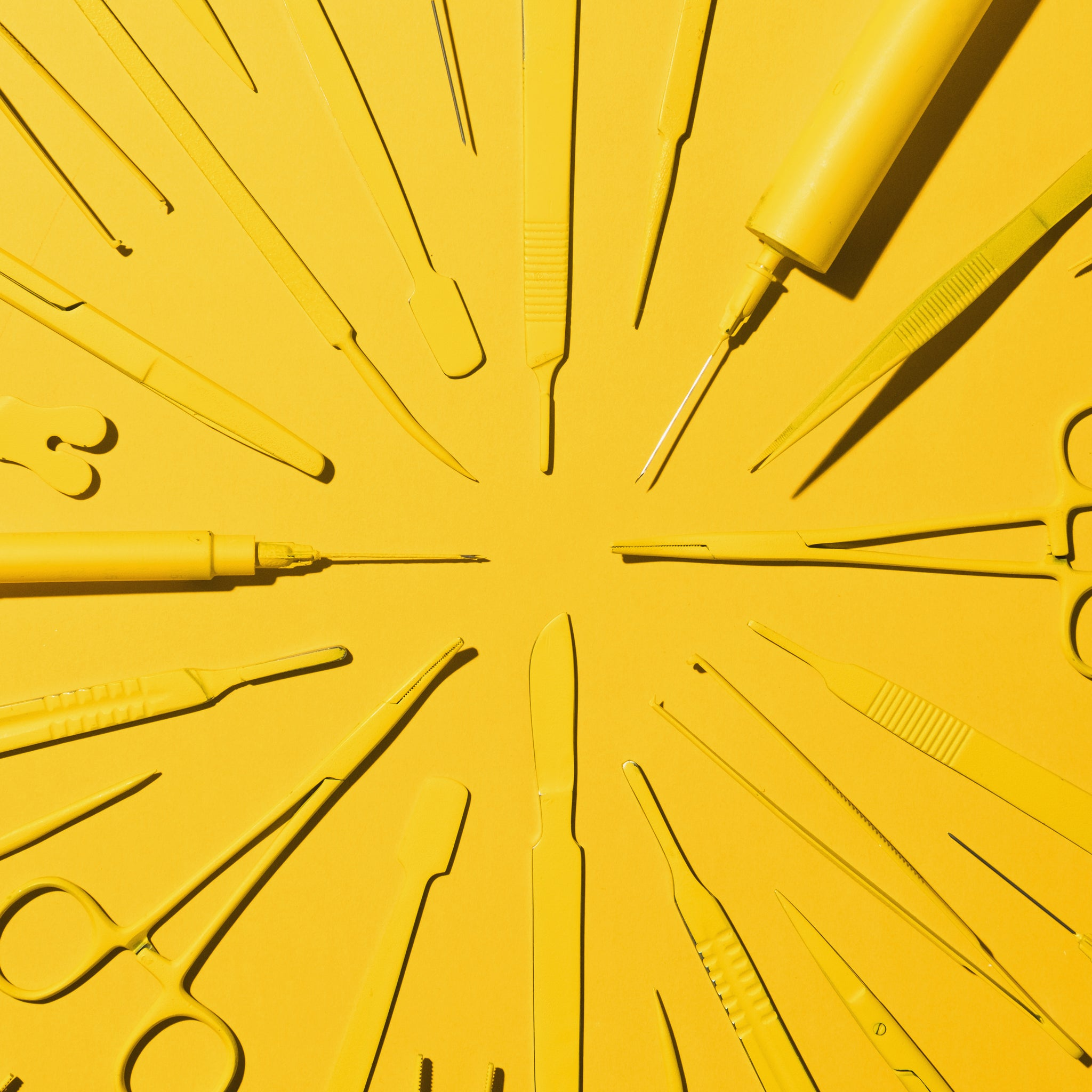 Bright yellow medical tools on a bright yellow background