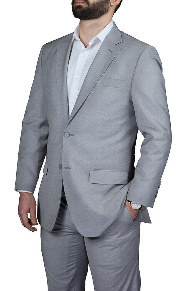 man wearing custom tailored made to measure light grey suit