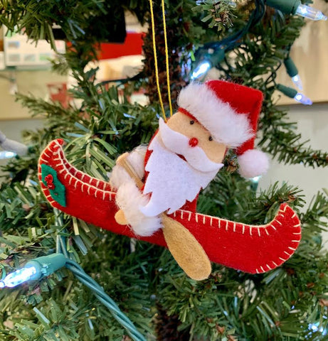 SANTA IN CANOE ORNAMENT