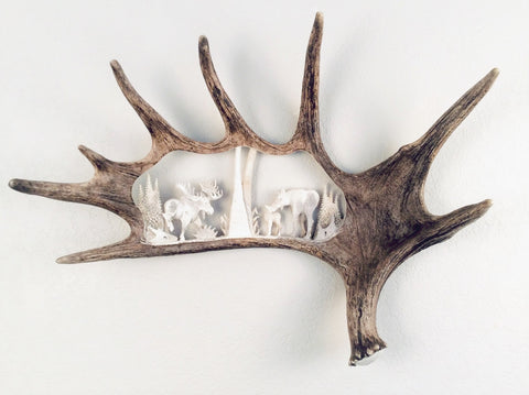 MOOSE FAMILY HANGING ANTLER CARVING