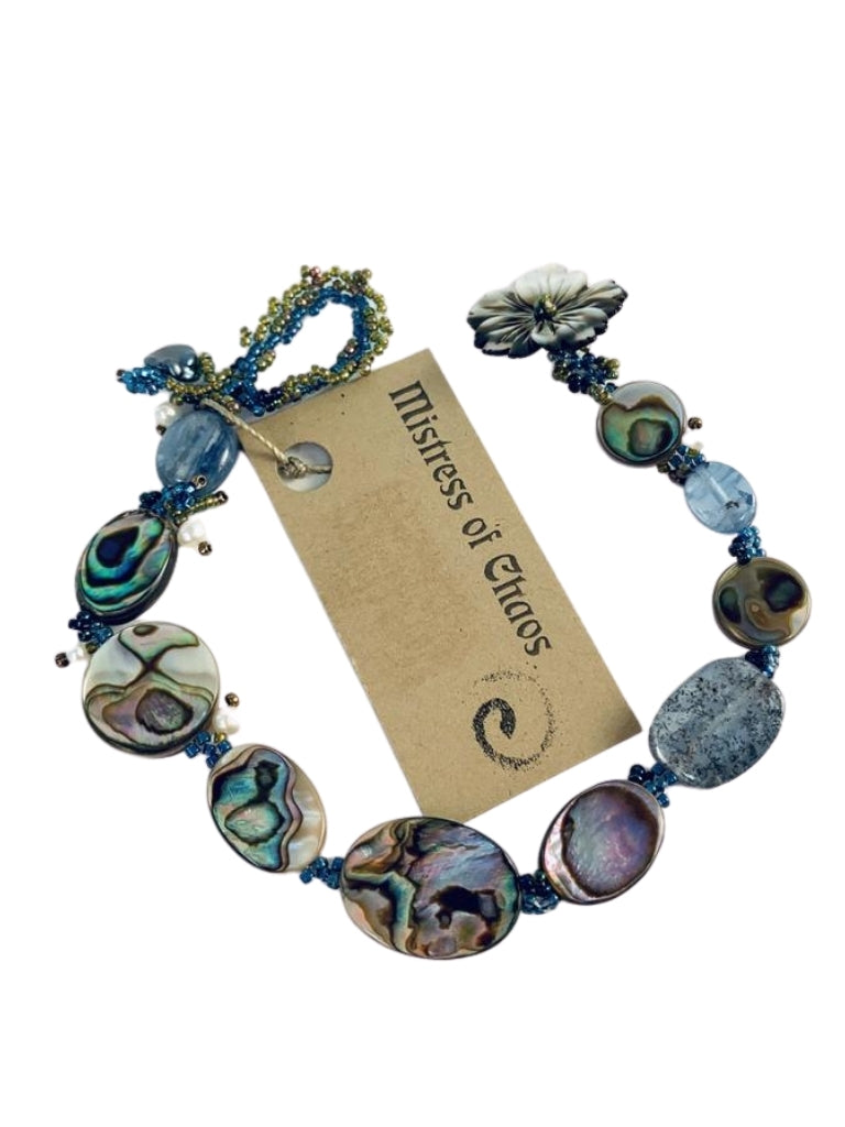 SHELL, KYANITE, AND PEARL BRACELET