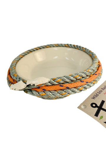 ORANGE LONGLINE BASKET WITH WHITE CERAMIC DISH AND TWO FISH EMBELLISHMENT