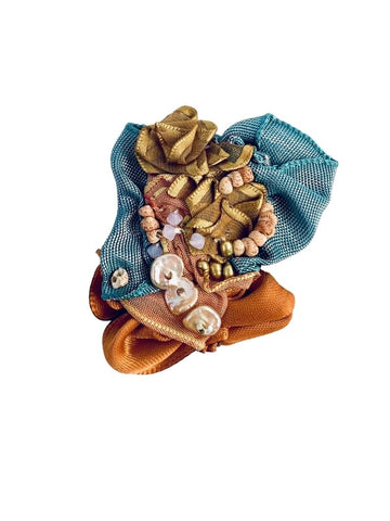 AQUA, RUST, AND GOLD RIBBON PIN WITH PEARLS AND SHELLS