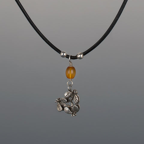 BUZZZ-B PENDANT AMBER ON LEATHER CHAIN