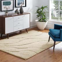 ABOUND ABSTRACT SWIRL 5X8 SHAG AREA RUG IN CREAME AND BEIGE