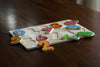 Image of Classic Numbers Wooden Puzzle, Preschool Age w/ Colorful Wood Pieces & Shape Cut-Outs in Board