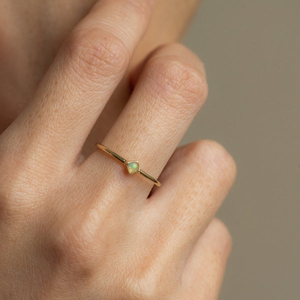 Ali Opal gold ring worn on hand model