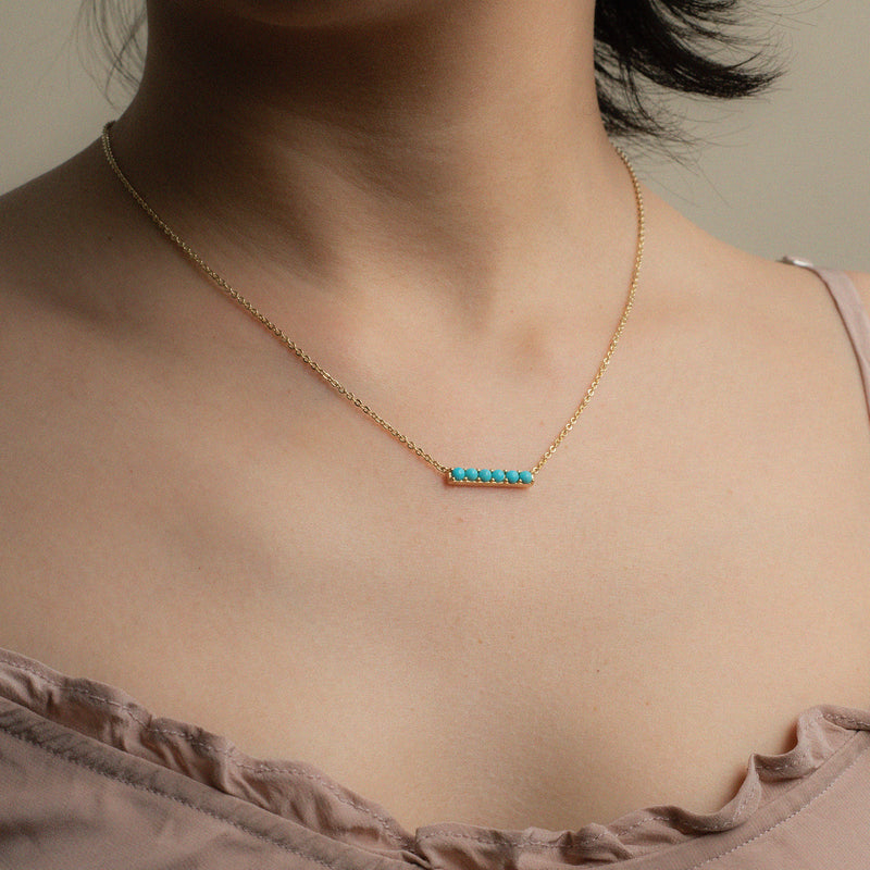 Turquoise gold necklace Kira worn on model
