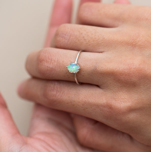 Opal white gold ring Estelle worn on model