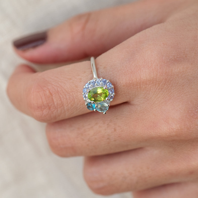 Peridot, Tanzanite, London Blue Topaz, and Blue Topaz white gold ring Marjorie worn on hand