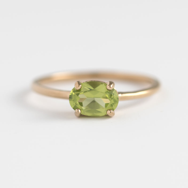 Payton Peridot on gold ring