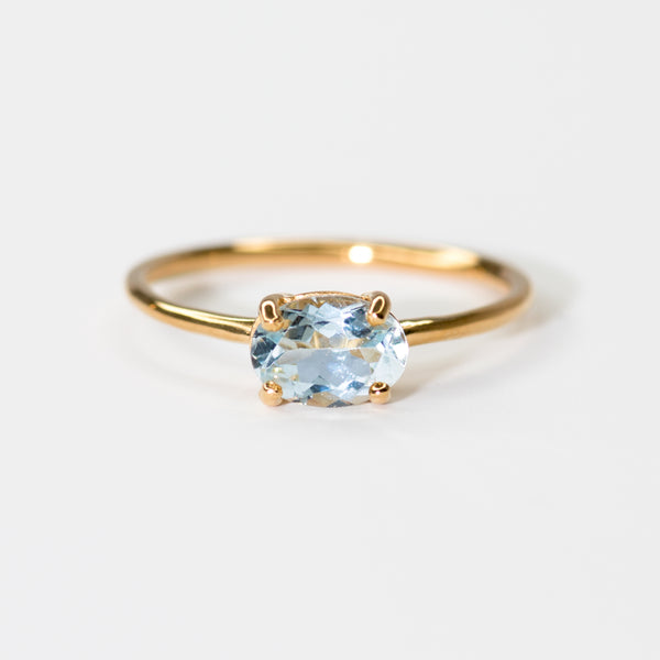 Blue Topaz on Gold band Breanne