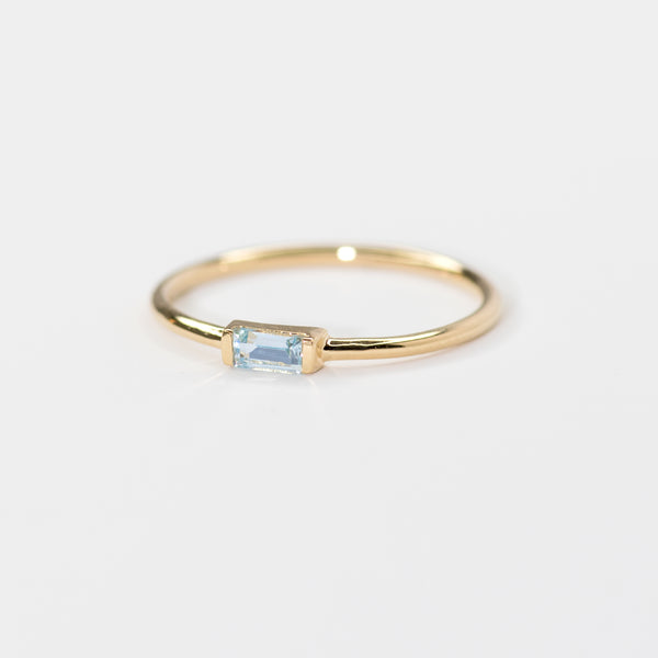 Blue Topaz on gold band Caroline