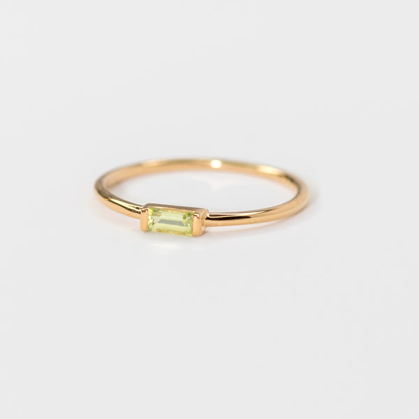 Peridot on gold band Paige