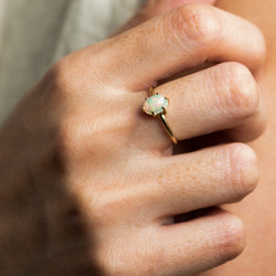 Everly Opal and gold ring worn on hand