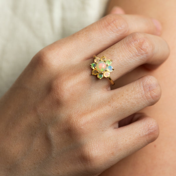Delilah Opal gold ring worn on hand