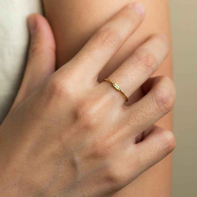 Paige Peridot gold ring worn on hand model