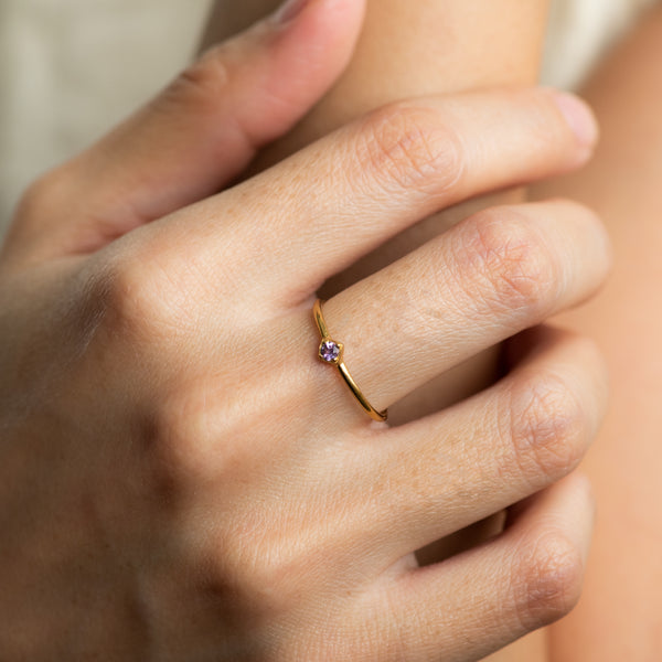 Maile Amethyst on gold ring worn on hand model