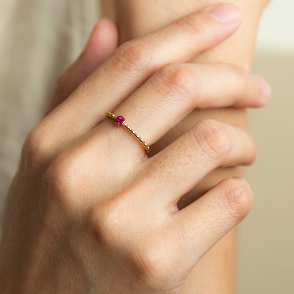 Levia Ruby on gold ring worn on hand model