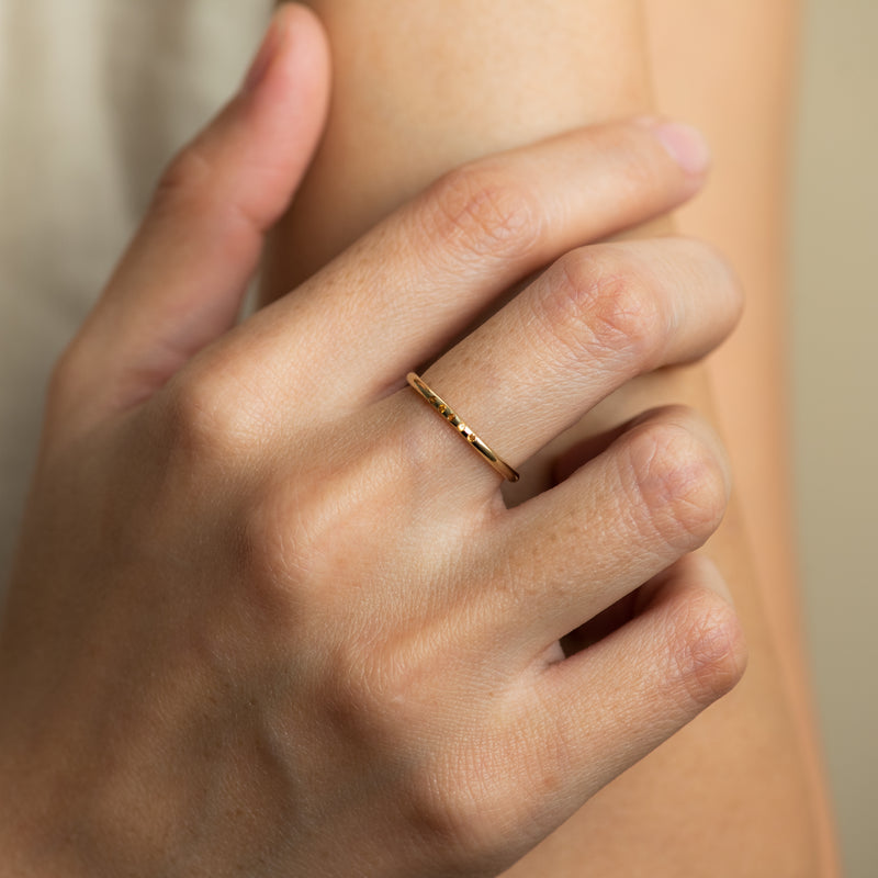 Naomi Citrine on gold ring worn by hand model