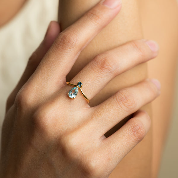 Grace Blue Topaz on gold ring worn by hand model