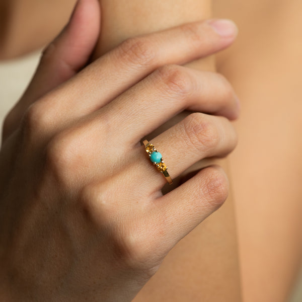 Turquoise and Citrine Gold ring Nora worn by hand model